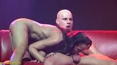 Kinky extreme deepthroat on public stage Thumb