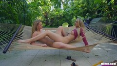 Naughty lesbians tribbing outdoors in the hammock Thumb