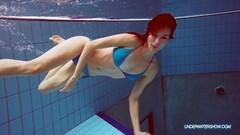 Redhead in blue bikini showing her awesome body Thumb
