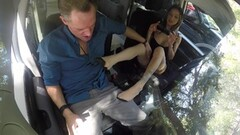 Naughty Nadia Styles giving a car footjob Thumb