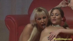 Hot lesbian orgy on public stage Thumb